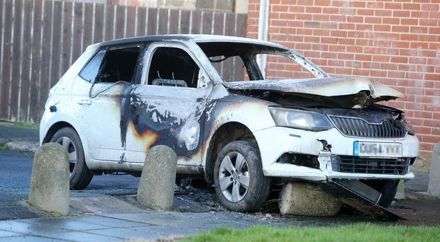 A burnt out car off Taghnevan Drive in Lurgan which was stolen during a hijacking in the town. (Picture by Jonathan Porter/Press Eye)