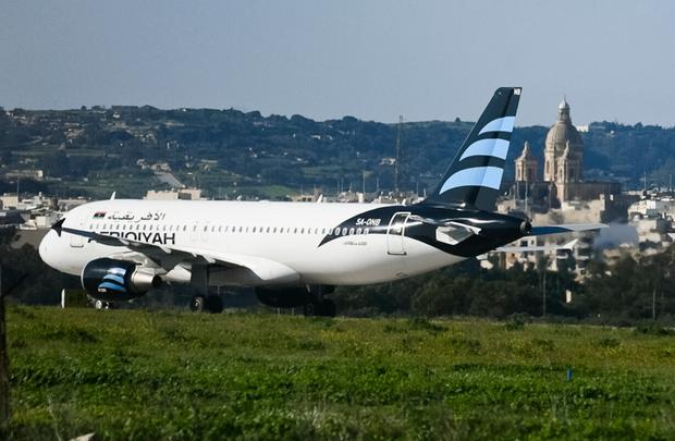 An Afriqiyah Airways plane from Libya stands on the tarmac at Malta's Luqa International airport, Friday, Dec. 23, 2016. (AP Photo/Jonathan Borg)