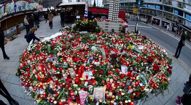 Powerful message: tributes left to those killed in the horrific attack at the Christmas market in Berlin and