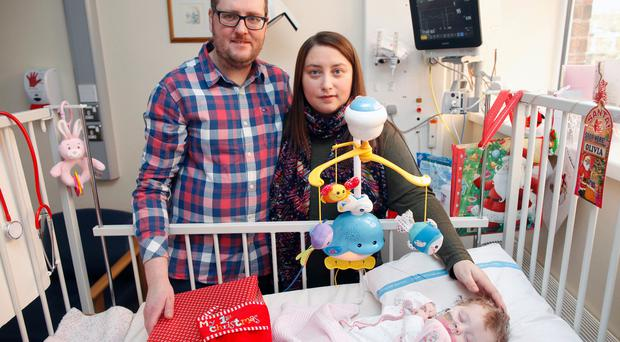 Diane and Peter Gilmour with daughter Olivia in the Royal Victoria Hospital