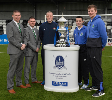 Final call: Stephen Gourley, David Murphy and Mark McClelland of Dundela pictured with Linfield players Johnny Frazer and Cameron Stewart ahead of today's Steel and Sons Cup Final
