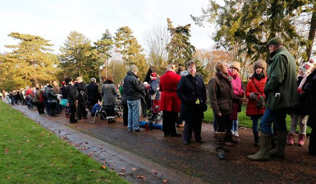Members of the public wait to see the royal family arrive to attend the morning Christmas Day service at St Mary Magdalene Church on the Sandringham estate in Norfolk.