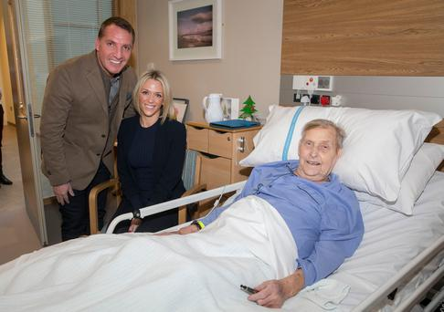 Celtic manager Brendan Rodgers and fiancee Charlotte Searle with patient Hubert Cowan from Whitehead, at the Northern Ireland Hospice in Belfast.