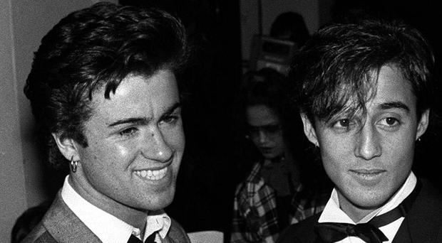 Wham's George Michael (left) and Andrew Ridgeley. Pop superstar Mr Michael has died peacefully at home, his publicist said. 30/03/84
