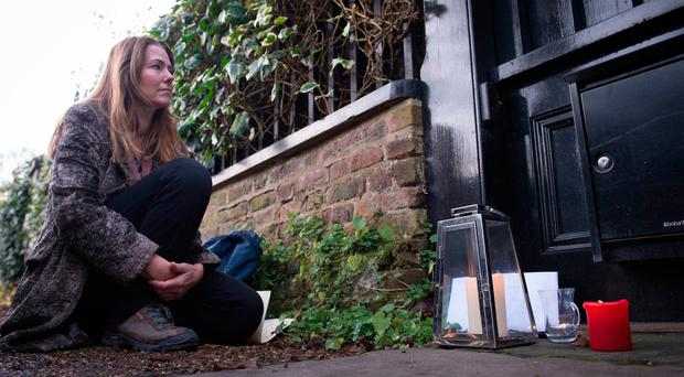 A George Michael fan outside his London home, as the pop superstar has died at the age of 53 from suspected heart failure.