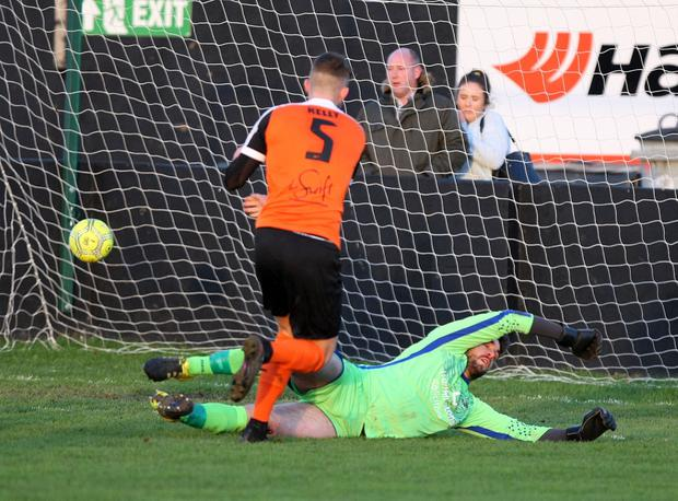 Daniel Kelly chips the ball past Aaron Hogg. Picture by Freddie Parkinson/Press Eye