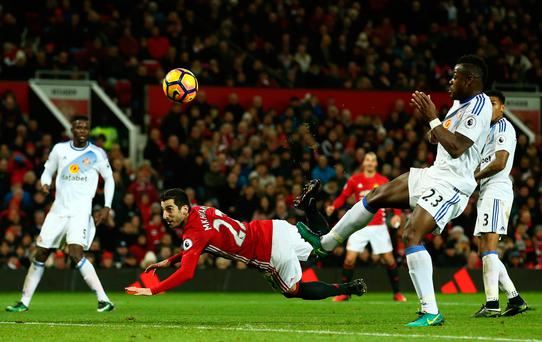 Outrageous flick: Henrikh Mkhitaryan scores Manchester United's third goal