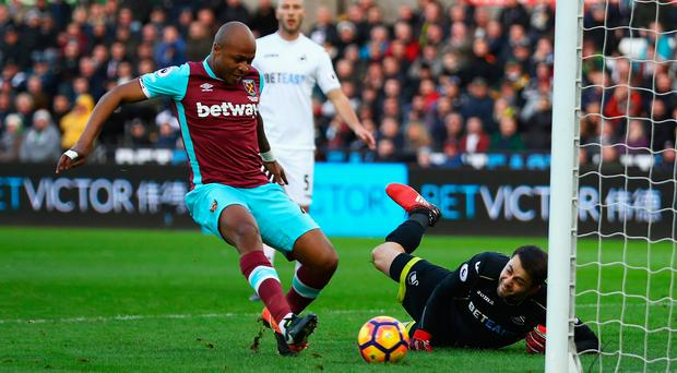 Back of the net: Andre Ayew opens the scoring against Swansea