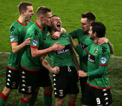 All square: Aaron Harmon celebrates with team-mates after heading Glentoran's equaliser