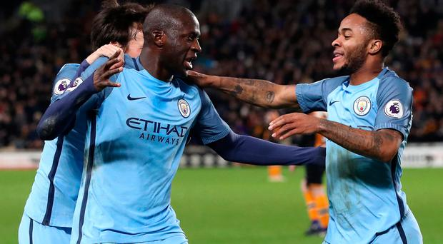 Yaya Toure (centre) celebrates scoring his side's first goal of the game