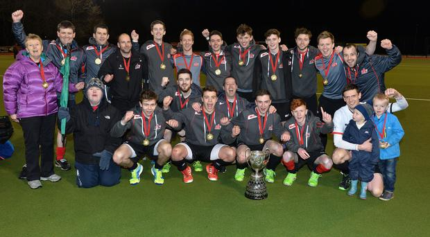 Just champion: Annadale, with player/coach Peter Caruth on crutches, celebrate their Kirk Cup final success over Cookstown at Stormont
