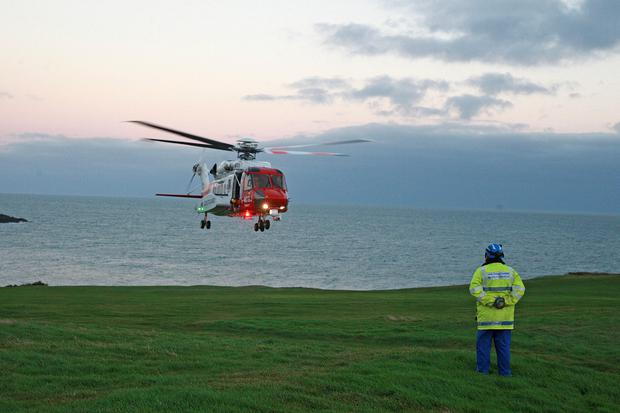 Helicopter 936 arrived and is in the process of transporting the man to the Royal Victoria Hospital. Photo: Bill Smyth