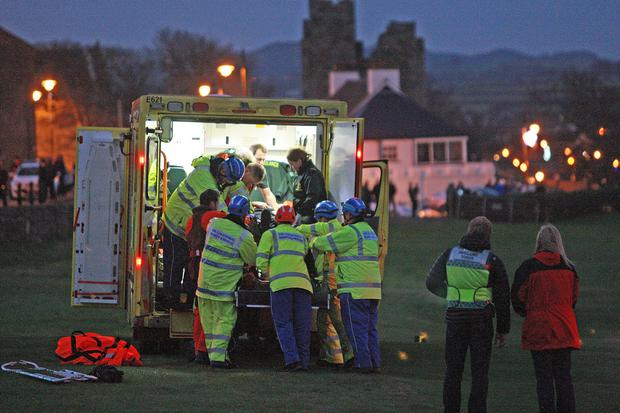 The Ambulance Service process of transporting the man to the Royal Victoria Hospital. Photo Bill Smyth