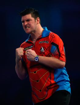 Victory roar: Daryl Gurney celebrates making it into the last 16