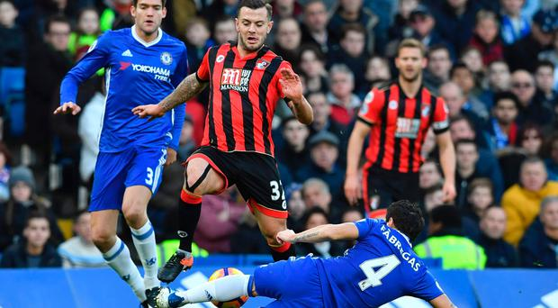 Too hot: Jack Wilshere and Bournemouth were sent packing