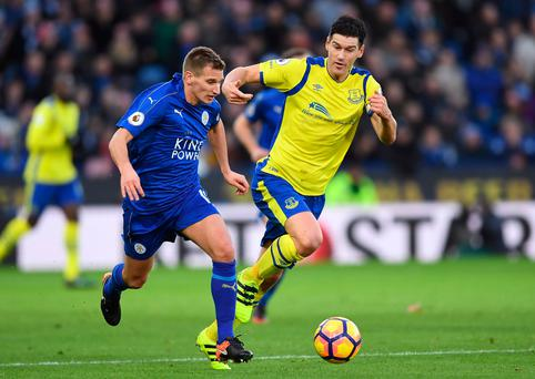 Duel: Gareth Barry pursues Marc Albrighton
