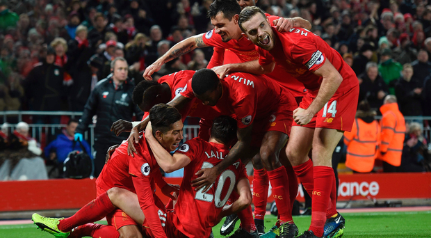 Turnaround: Roberto Firmino is mobbed after putting Liverpool ahead