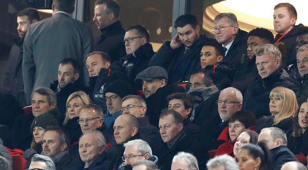 Face in the crowd: Pep Guardiola takes in the action at Anfield