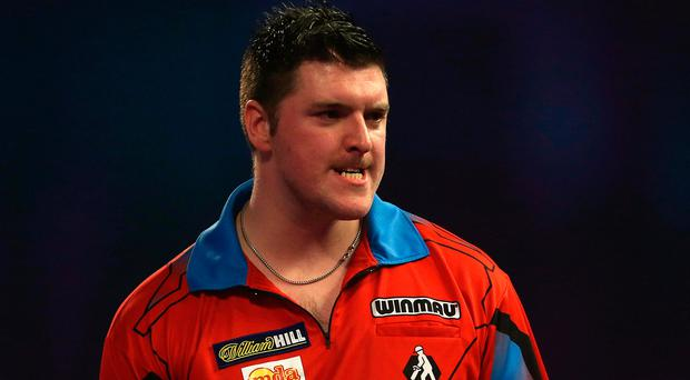 Title vision: Daryl Gurney has made sacrifices throughout his career in a bid to lift the World title, and has made it through to the last 16 for the first time. Photo: Steven Paston/PA