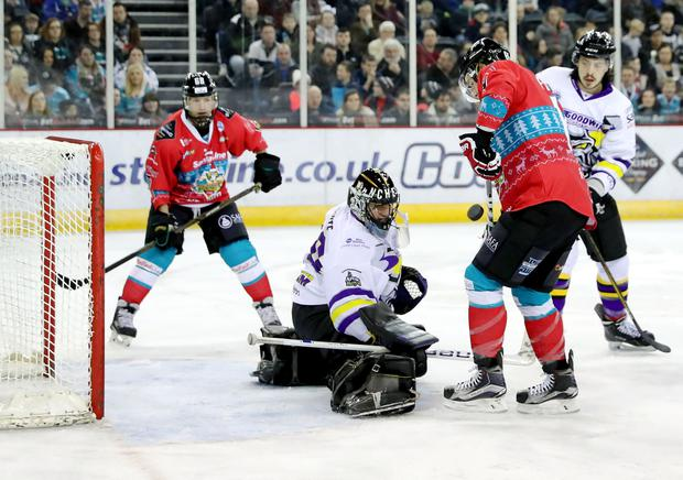 Belfast Giants' Michael Forney with Manchester Storm's Mike Clemente during Wednesdays Elite Ice Hockey League game at the SSE Arena, Belfast. Photo by William Cherry/Press Eye