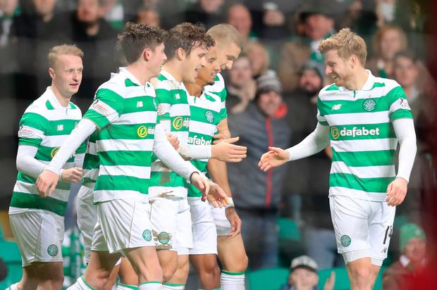 Celtic's Erik Sviatchenko (centre left) celebrates scoring his side's first goal of the game with teammates during the Ladbrokes Scottish Premiership match at Celtic Park, Glasgow. PA