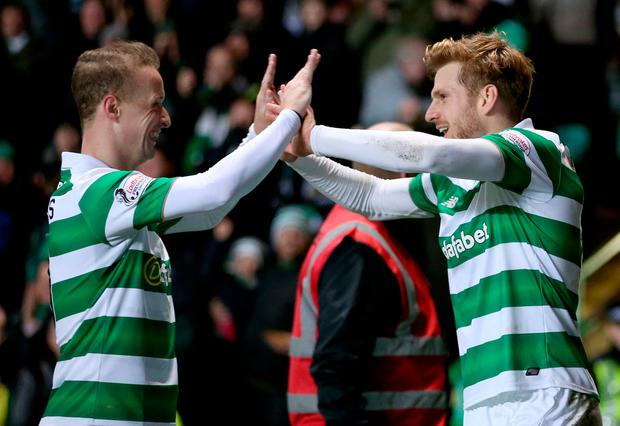 Celtic's Stuart Armstrong celebrates scoring his sides second goal with Leigh Griffiths (left) during the Ladbrokes Scottish Premiership match at Celtic Park, Glasgow. PA