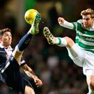 Up in the air: Celtic's Stuart Armstrong (right) challenges Christopher Routis. Photo: Jane Barlow/PA