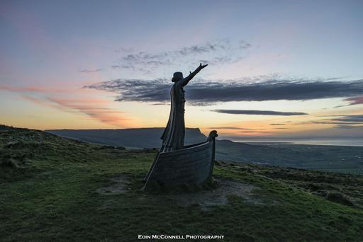 Manannan Mac Lir, the Celtic Sea God, looks out from his home on Binevenagh Mountain at sunset on Thursday December 29 2016. Photo by Eoin McConnell