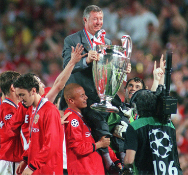 Glory trail: Sir Alex Ferguson with the European Cup after Manchester United's Champions League victory in 1999