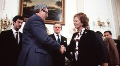 Thatcher and FitzGerald shake hands on the Anglo-Irish Agreement