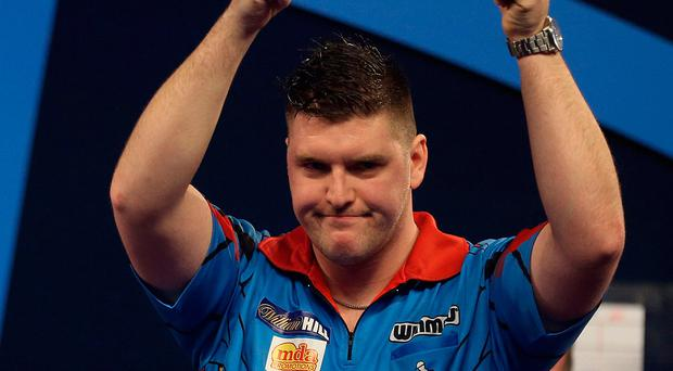Daryl Gurney acknowledges his fans during the William Hill World Darts Championship. Photo: Steven Paston/PA