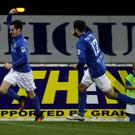 Net gains: Glenavon's Andy McGrory wheels away after putting his side 2-0 up