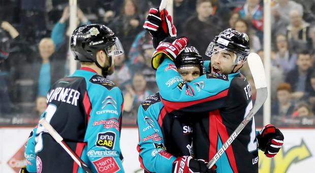 Top shot: Belfast Giants' Alex Foster celebrates scoring against Braehead Clan during last night's Elite League clash at the SSE Arena
