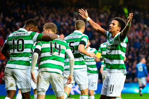 GLASGOW, SCOTLAND - DECEMBER 31: Scott Sinclair (R) of Celtic celebrates scoring his team's second goal during the Ladbrokes Scottish Premiership match between Rangers and Celtic at Ibrox Stadium on December 31, 2016 in Glasgow, Scotland. (Photo by Mark Runnacles/Getty Images)