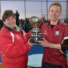 Just champion: Armagh captain Callum Kilpatrick receives the trophy from president of Ulster Hockey, Liz Lamont