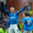 Great start: Kenny Miller celebrates putting Rangers in front, but Celtic hit back to end the Ibrox men's proud home record
