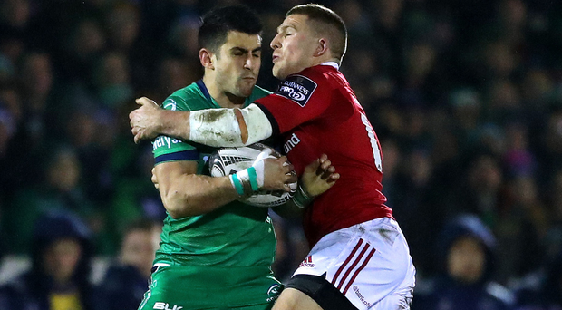 Hold on: Connacht's Tiernan O'Halloran with Andrew Conway