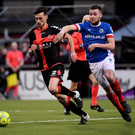 Fight to finish: Stephen Lowry pursues Declan Caddell in the top of the table clash at Seaview