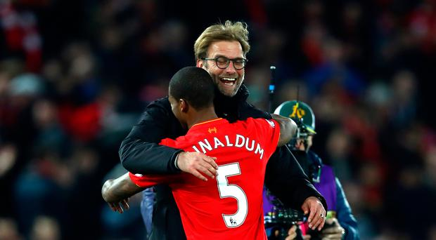 Job well done: Jurgen Klopp is all smiles as he hails Georginio Wijnaldum after the win over City