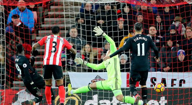 Liverpool's Sadio Mane (left) scores his side's second goal of the game during the Premier League match at the Stadium of Light, Sunderland. PA