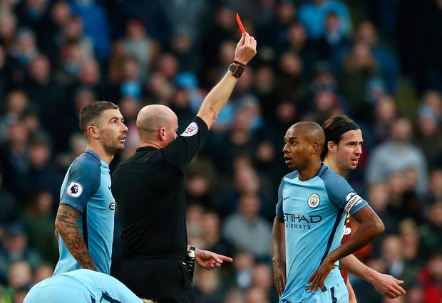 Referee Lee Mason shows the red card to Fernandinho of Manchester City after his challenge on Johann Gudmundsson of Burnley during the Premier League match between Manchester City and Burnley at Etihad Stadium on January 2, 2017 in Manchester, England. (Photo by Jan Kruger/Getty Images)
