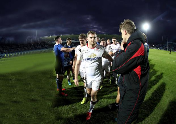 Dejected: Darren Cave and the rest of the Ulster side leave the pitch after defeat by Leinster at the RDS