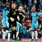 Off you go: City's Fernandinho is shown the red card by referee Lee Mason after (inset) lunging at Johann Berg Gudmundsson