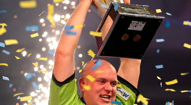 World in motion: Michael van Gerwen with the Sid Waddell trophy