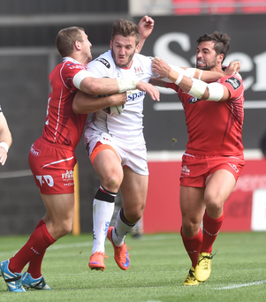 Hang on: Stuart McCloskey last season at Parc y Scarlets, a venue where Ulster have struggled.