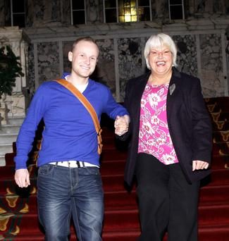 Ruth Patterson leaves the council chamber with loyalist blogger Jamie Bryson
