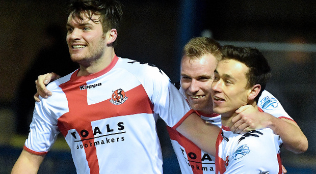 Ard to beat: (l/r) Philip Lowry, Andrew Mitchell and two goal Paul Heatley celebrate as Crusaders extend their Premiership lead to seven points. Photo: Stephen Hamilton/Presseye