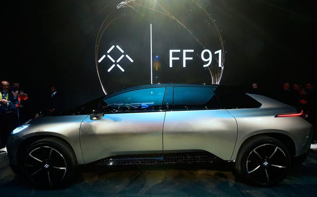 Faraday Future's just introduced FF91 electric vehicle on display at the company's press conference at the 2017 Consumer Electronics Show (CES2017) in Las Vegas, Nevada, on January 3, 2017. AFP/Getty Images