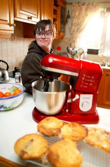Ryan Bogues bakes a batch of cookies in his kitchen