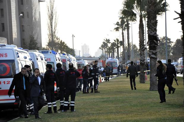 Security members and ambulances attend the explosion site in the Aegean city of Izmir, Turkey, Thursday, Jan. 5, 2017. (IHA via AP)